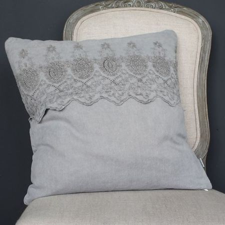 Grey linen cushion with embroidered band